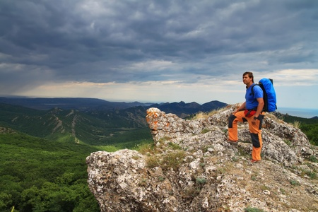 abseiling: Traveler on the top of the mountain