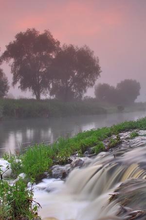 Waterfall on sunrise photo