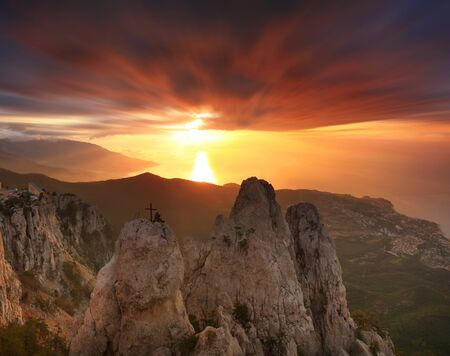 Gold sunrise in the mountains photo