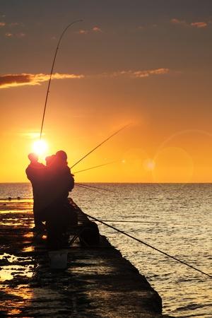 fishingpole: Silhouette of fishermen at sunrise
