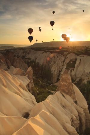 Hot air balloon over rock formations in Cappadocia, Turkey