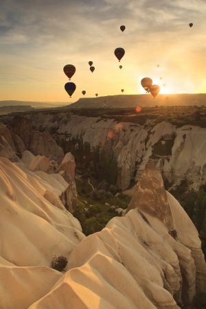 Hot air balloon over rock formations in Cappadocia, Turkey