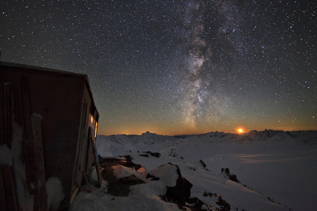 Milky Way and a house in the mountains photo