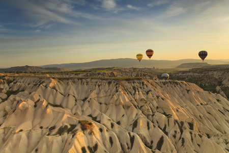 Balloons in Cappadocia over the hills