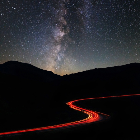 Road in the mountains under the Milky Way photo