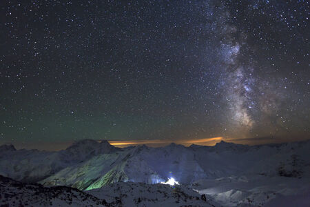 Milky Way and the moon over the Caucasus mountains photo