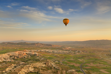 Balloon in Cappadocia over the hills photo