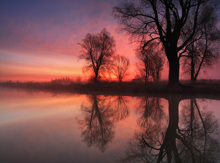 Sunrise reflection in the river Stock Photo