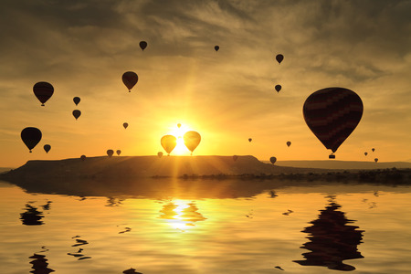 Balloons in Cappadocia at dawn sky background photo