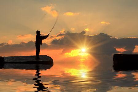 bass fishing: Fisherman on pier at sunset