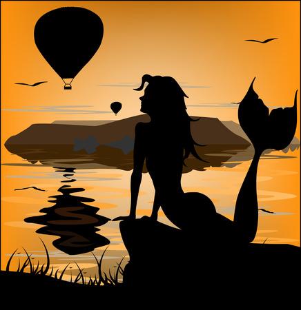 Mermaid silhouette on sunset