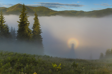 Optical illusion Brocken specter in the misty mountains
