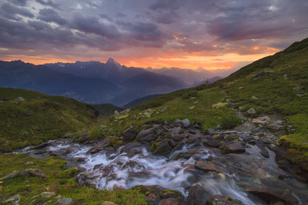 A mountain stream on a background of a beautiful sunset photo
