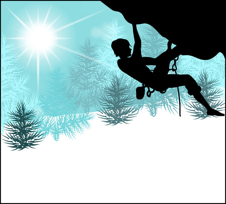 Silhouette of a climber on a background of snow winter landscape