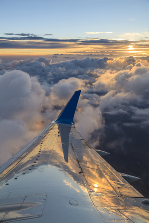 View of the clouds and airplane wing from the Inside