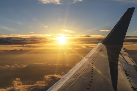 cloudscapes: View of the clouds and airplane wing from the Inside