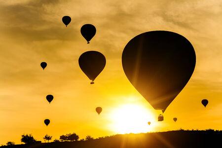 beautiful sunset: Many balloons at sunset sky background