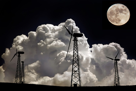 Wind generators on a background of amazing lunar sky photo