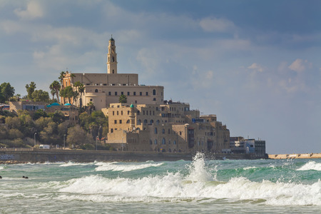 View of old Jaffa and big waves.