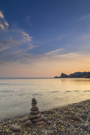 equipoise: Cairn on the seashore. Scenic evening seascape.