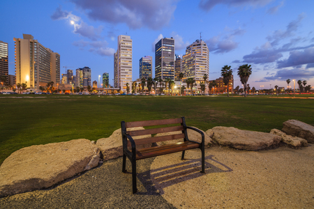 Lonely bench against the evening Tel Aviv.