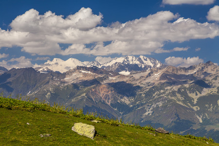 blessedness: Amazing landscape with high mountains under the blue sky and white clouds.