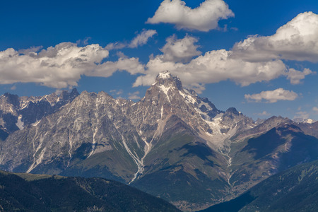beatitude: Amazing landscape with high mountains under the blue sky and white clouds.