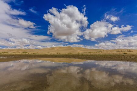 desert scenes: Gobi Desert after rain. Reflection of clouds in pools. Stock Photo