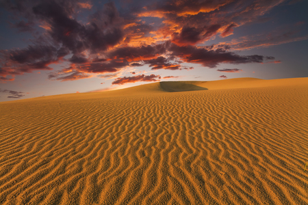 gobi: Majestic fiery sunset in the Gobi Desert. Mongolia.