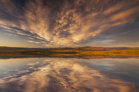 glistening: Reflection of a cloudy sky in the lake.