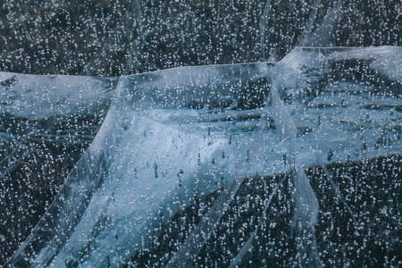 interstice: Abstract winter icy background. Icy Lake Baikal. Stock Photo