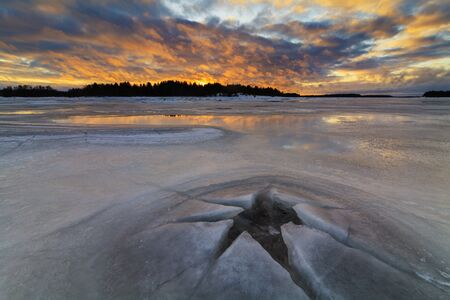 winter evening: Beautiful winter evening on the icy river. Stock Photo