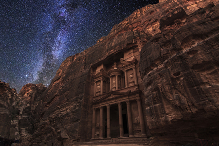 Ancient Petra on the background of the night starry sky. Jordan. Stock Photo