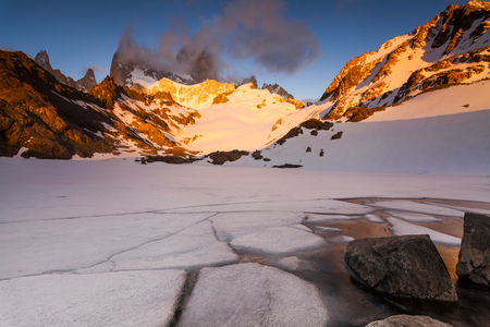 fitz: Fitz Roy in the rays of the sunset. Patagonia. Argentina. Stock Photo