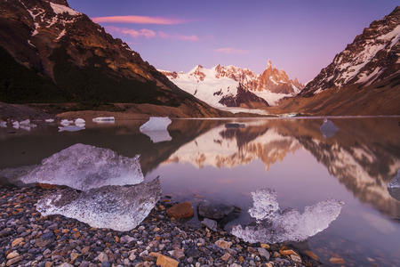fitzroy: Cerro Torre, Los Glaciares National Park. Reflection of mountains in the lake at sunset.