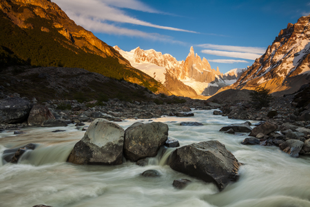 cerro fitzroy: Cerro Torre, Los Glaciares National Park. Mountains and river at sunset.