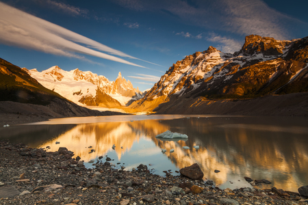 Cerro Torre, Los Glaciares National Park. Reflection of mountains in the lake at sunset.