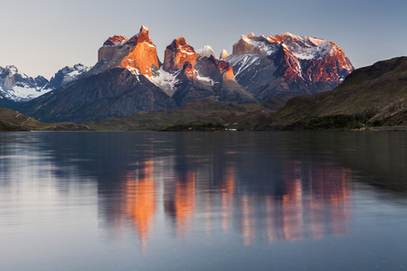 Reflection of the mountains in the lake. National Park Torres del Paine, Chile.