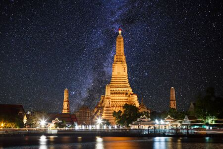 temple tower: Wat Arun temple on the background of the starry sky. Bangkok. Thailand. Stock Photo