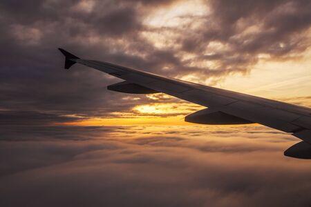 plane window: Beautiful sunset. View from the plane window