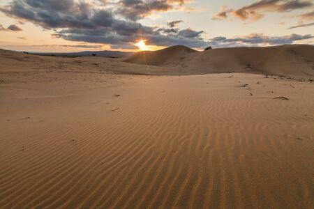 hummock: Colorful sunset over the dunes of the Gobi Desert. Mongolia.
