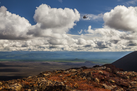 Flying helicopter over the volcanic landscape of the Kamchatka Peninsula