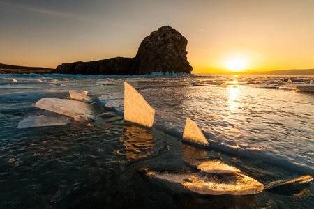 shamanism: Sunset at Lake Baikal in winter. Russia Stock Photo