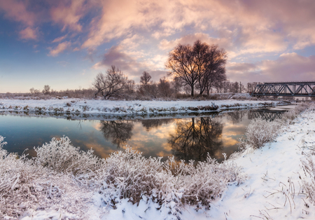 Dawn over the river in a frosty winter morning
