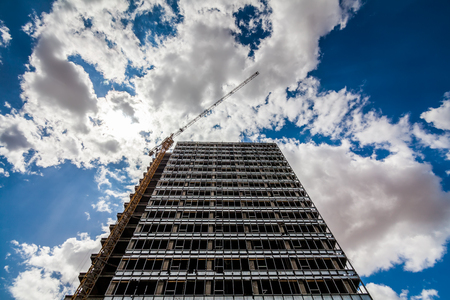 Crane and building construction on cloudy sky Stock Photo