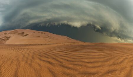 desert storm: Thunderclouds in the desert during a storm Stock Photo
