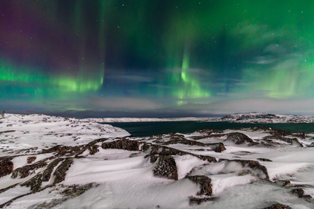the arctic ocean: Northern Lights on the shore of the Arctic Ocean.