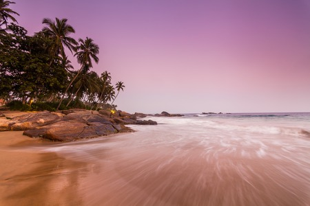 extremely: Extremely beautiful sunset under the coconut plams Stock Photo