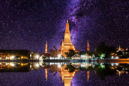 Wat Arun under milky way stars and space dust in the night sky, Bangkok, Thailand