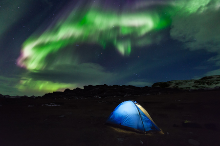 ionosphere: Camping in the north with the northern lights overhead Stock Photo